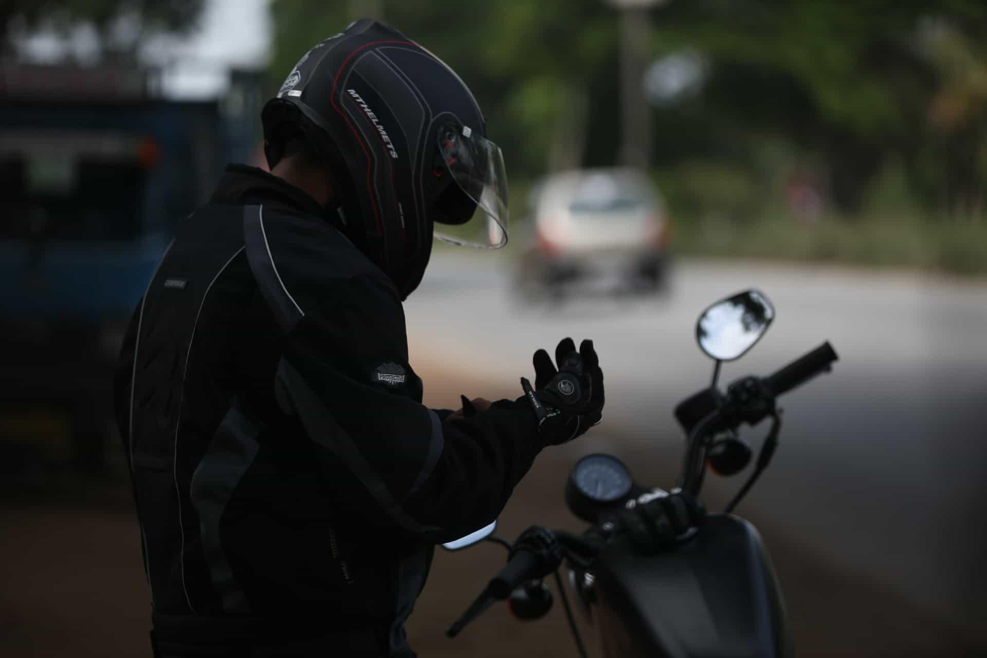 man taking off gloves