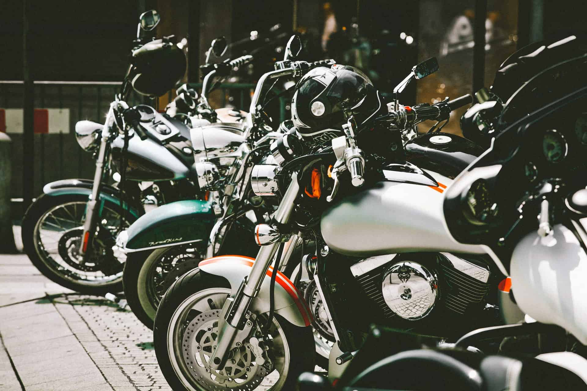 parked motorcycles helmets