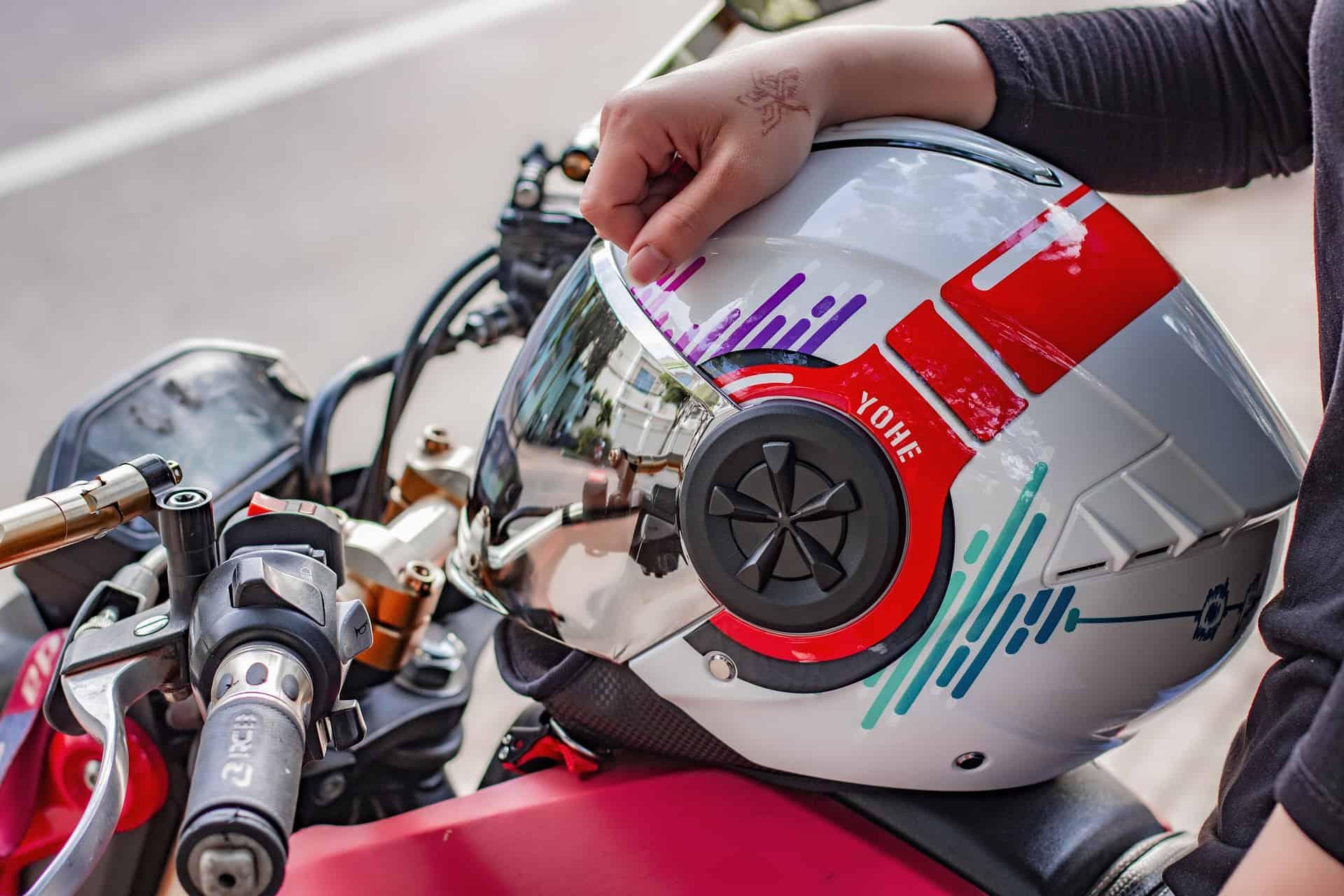 white red helmet hand