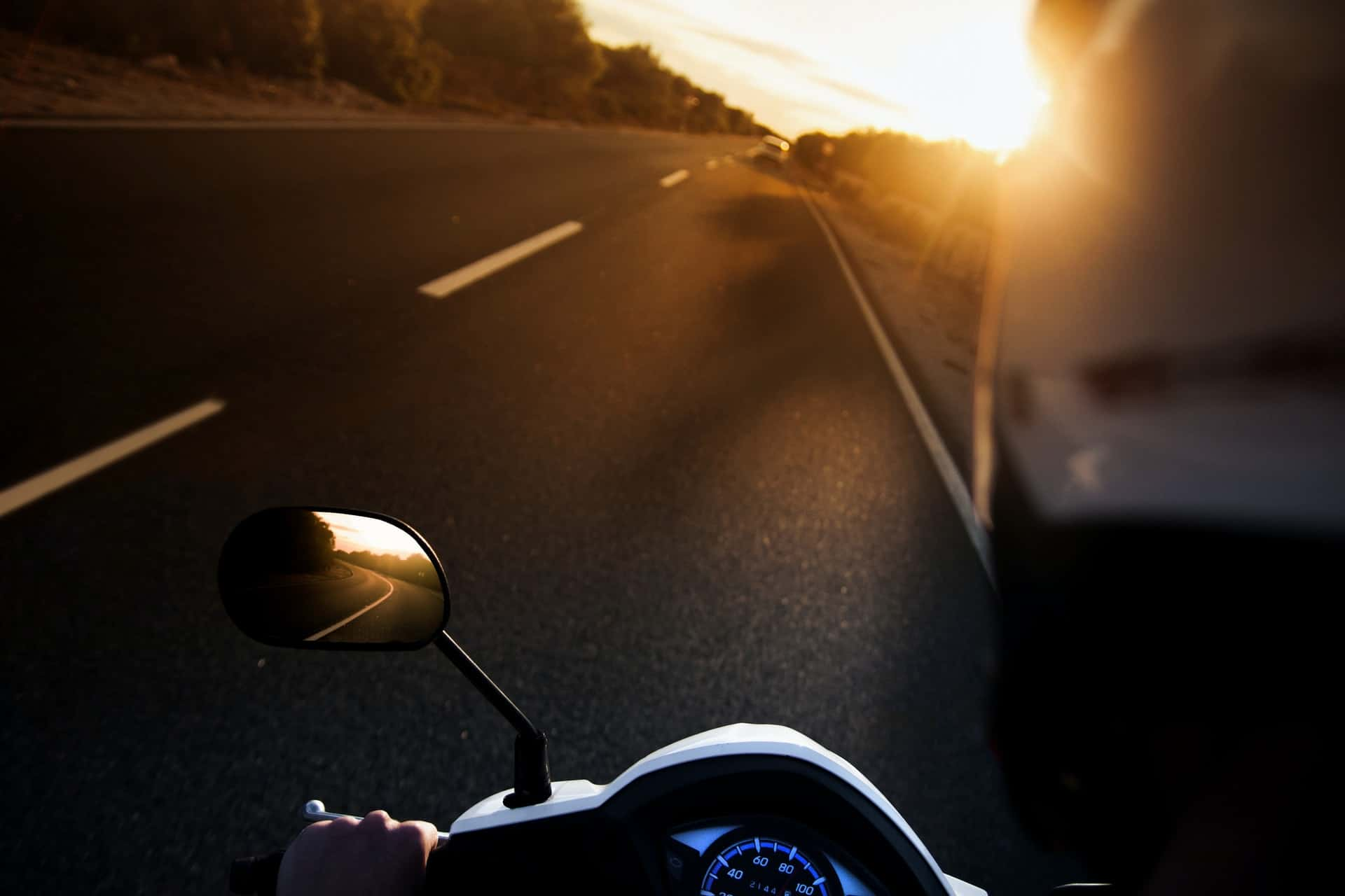 riding-motorcycle-sunlight