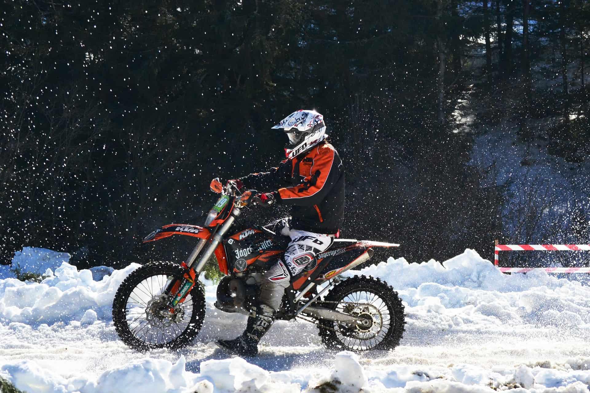 snowy rough terrain motorcycle