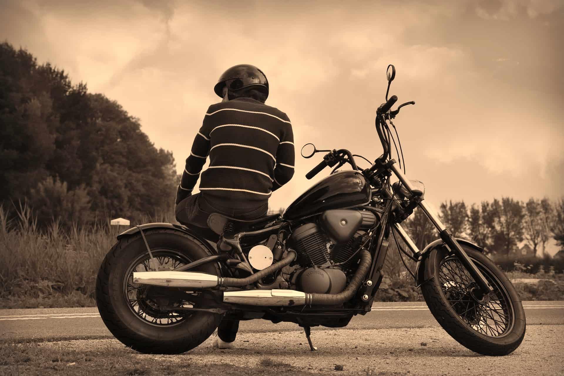 sepia motorcycle helmet man