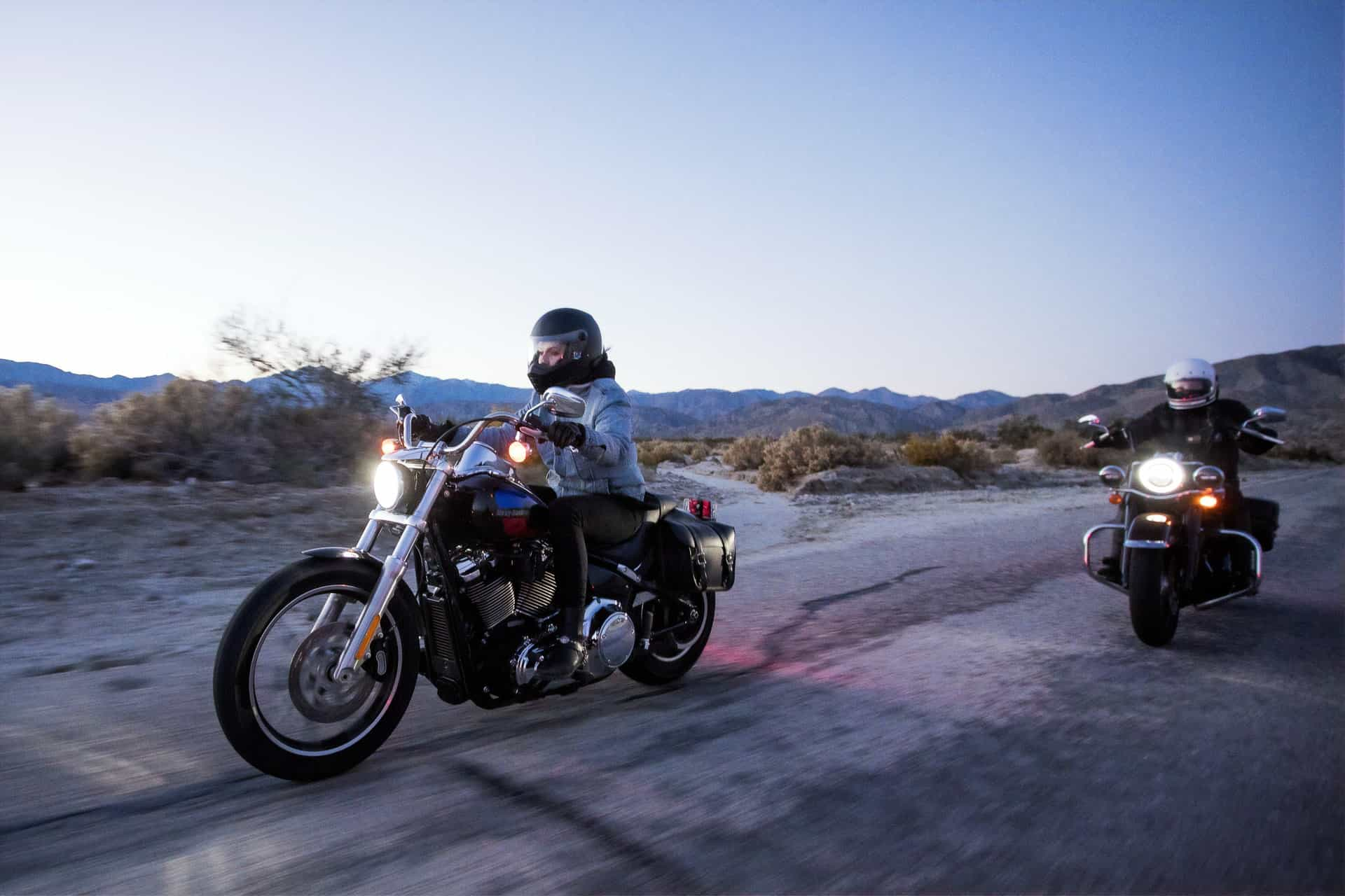 two people riding motorcycles