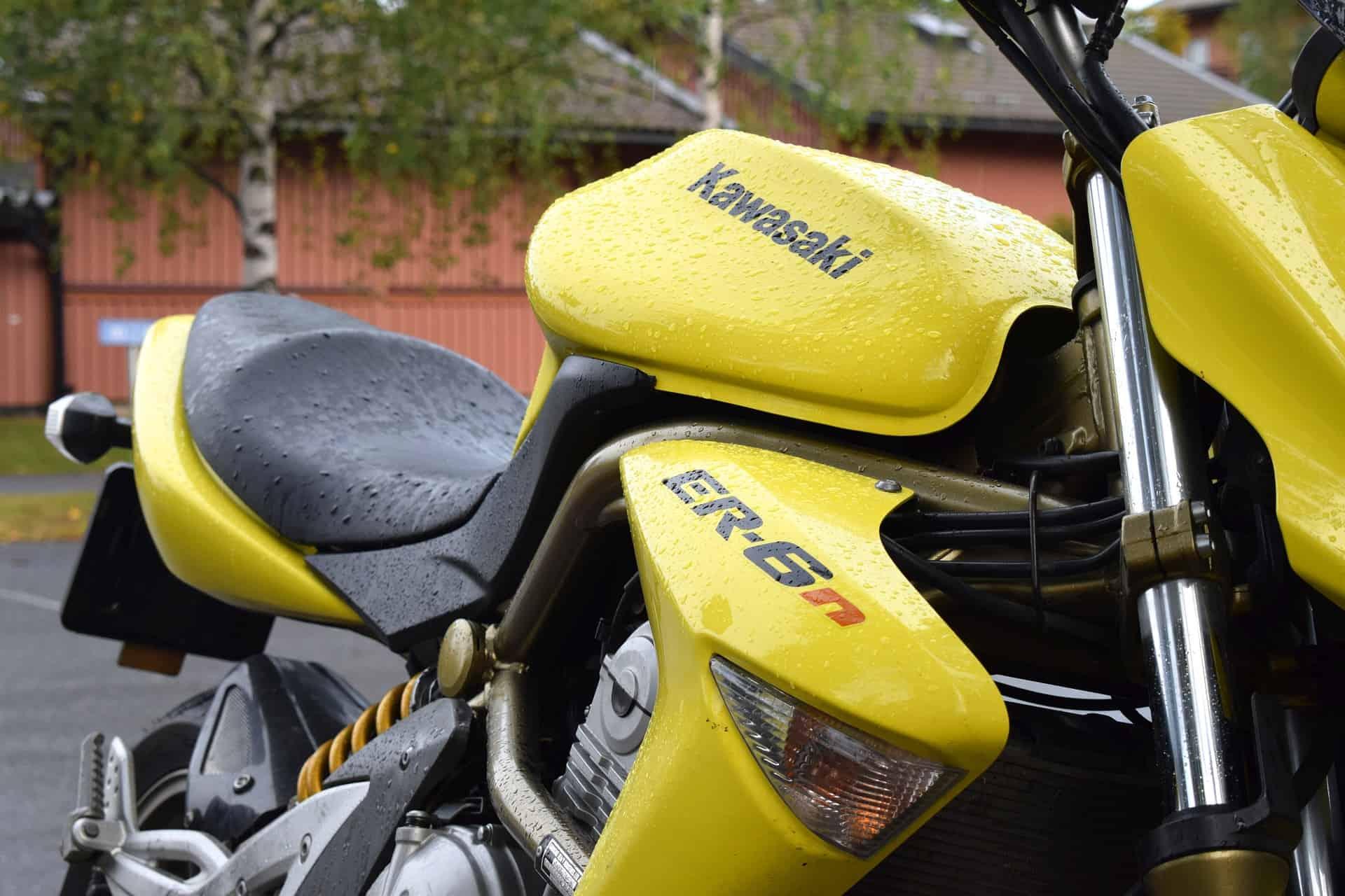 wet yellow motorcycle