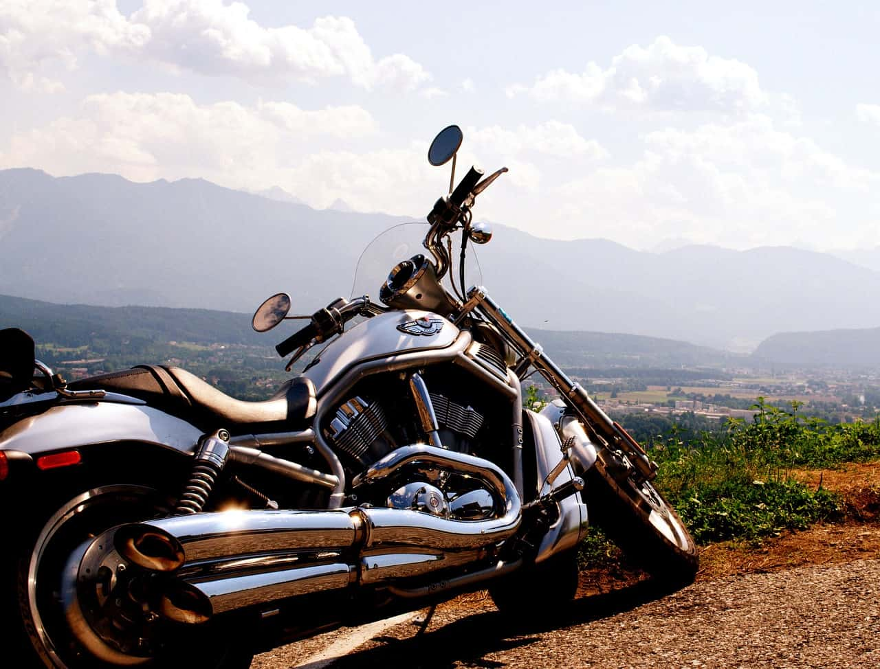 steel exhaust motorcycle mountains