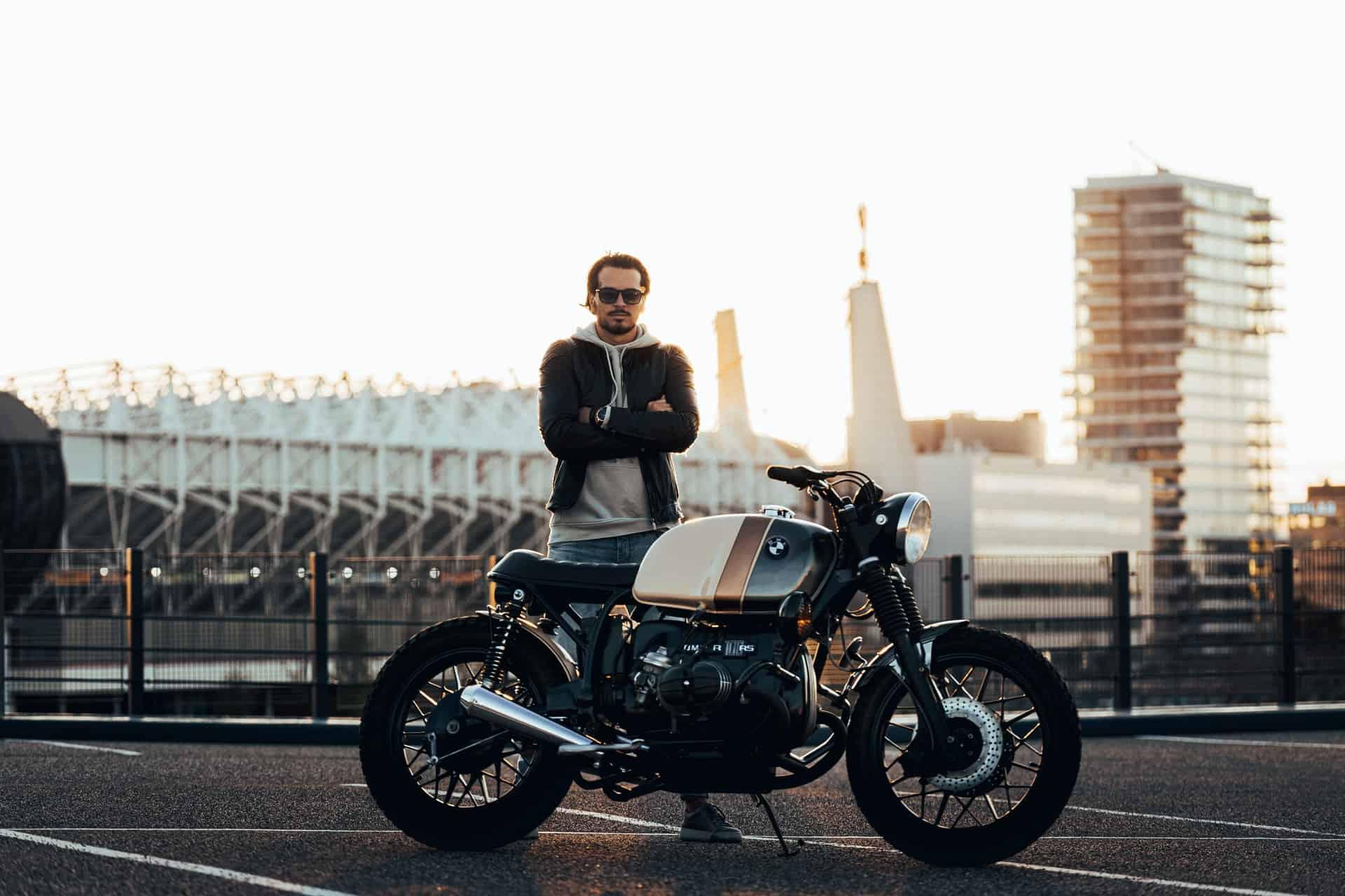 man standing motorcycle