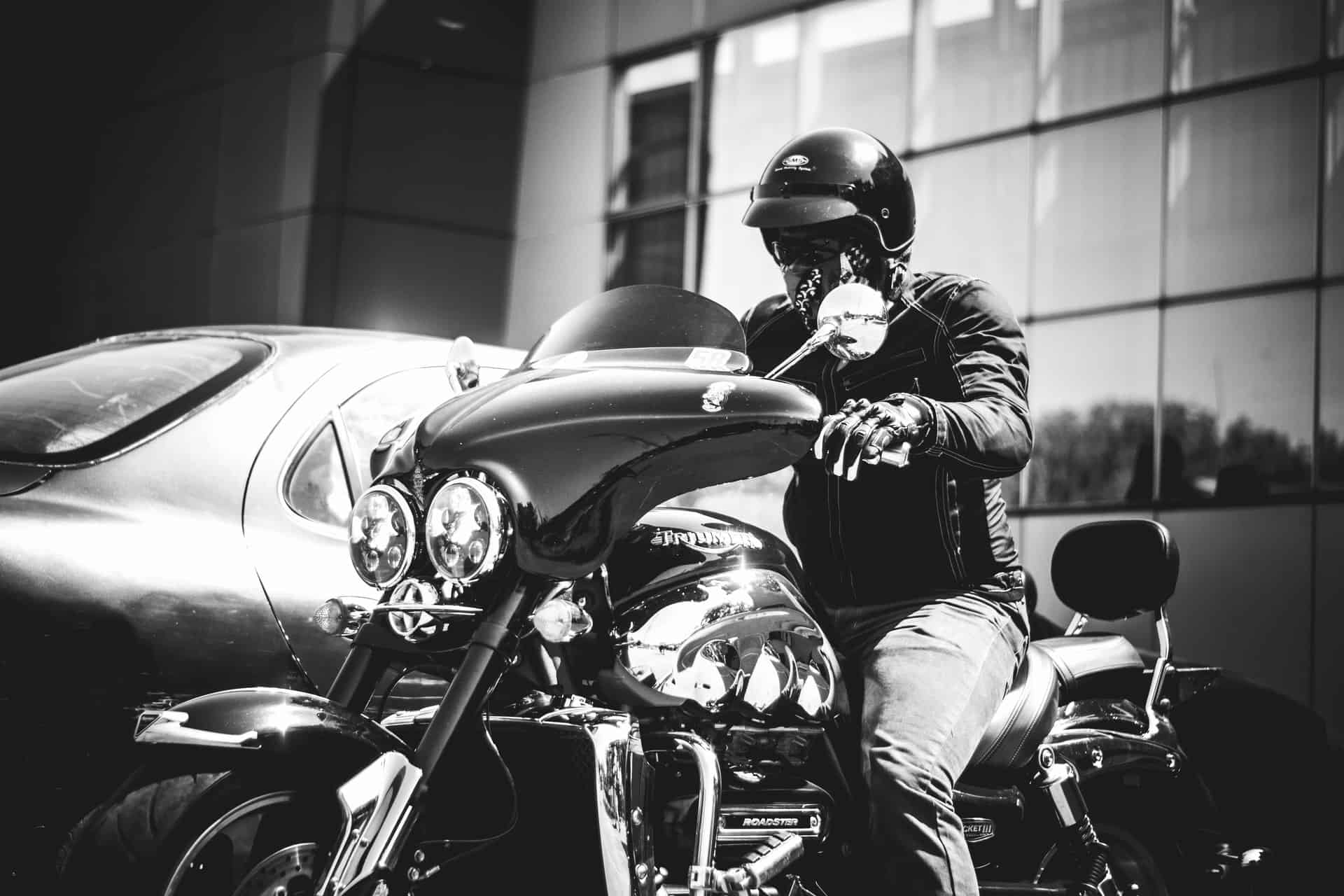 monochrome motorcycle wearing glasses