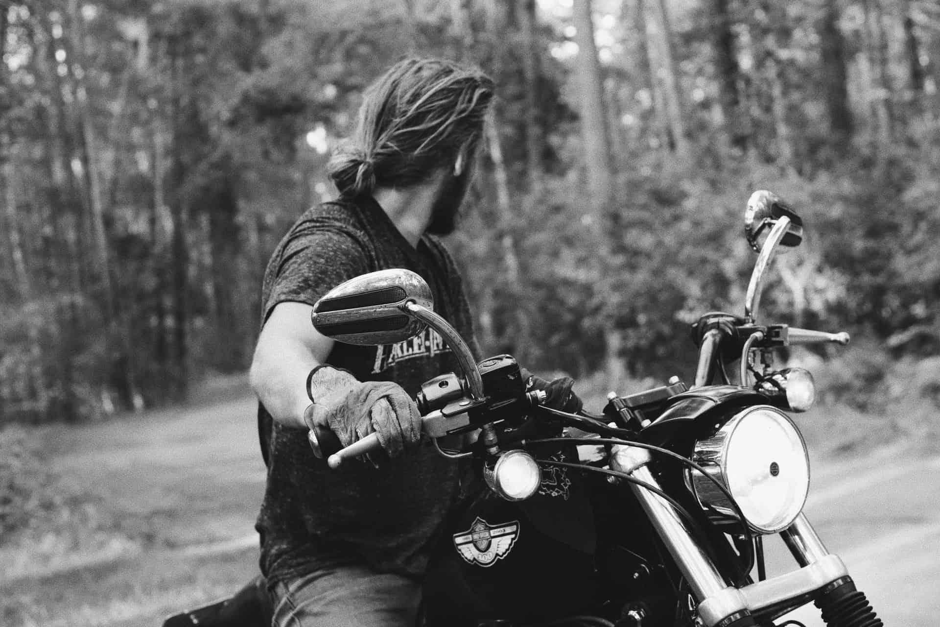 monochrome man motorcycle
