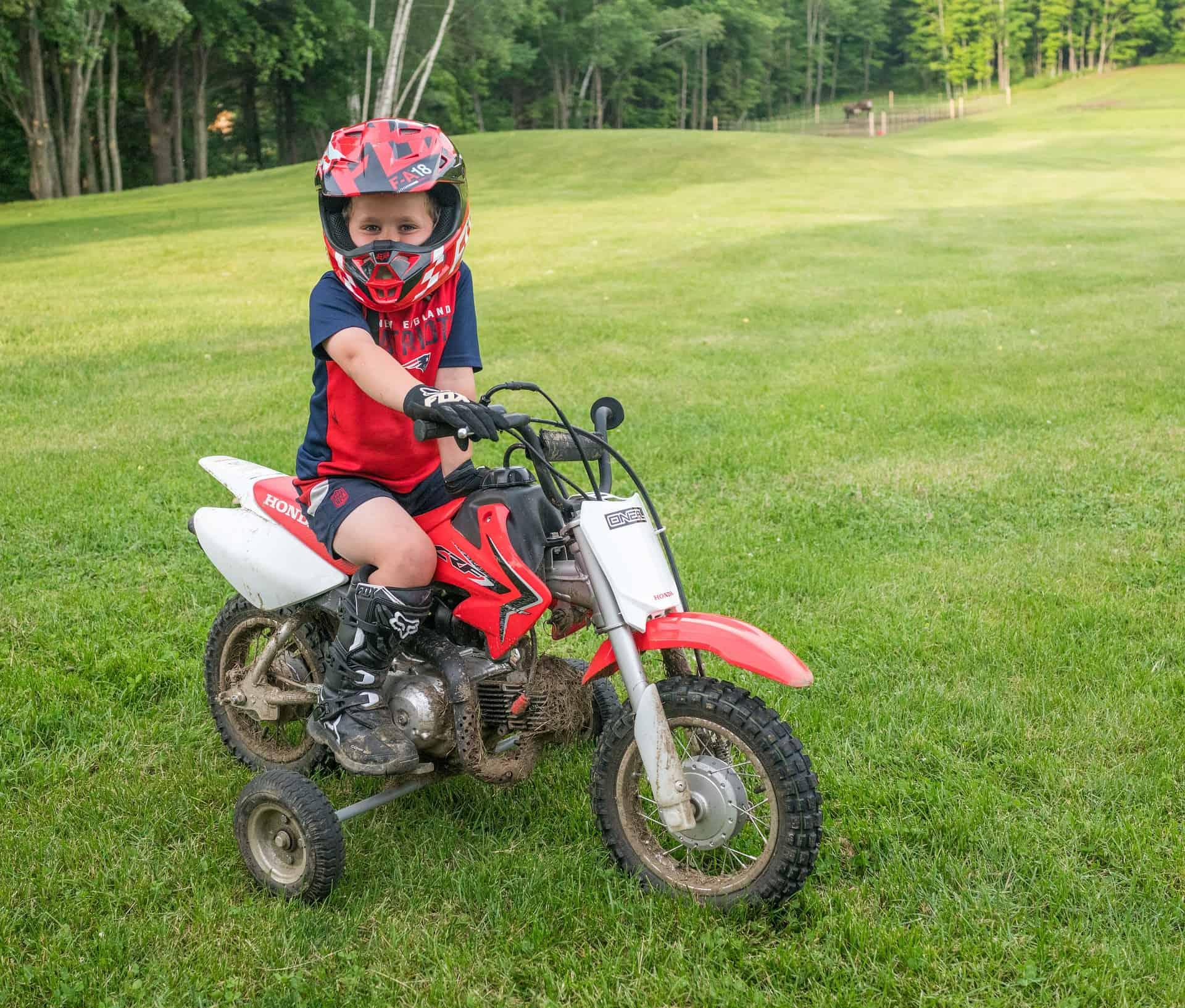 smiling boy dirt bike